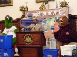 A typical scene in my native homeland: The Phillie Phanatic, recycling mascot Curby Bucket, Mayor Michael Nutter and the St. Joe's Hawk sign landmark legislation that moves the city to single-stream recycling. That's just how we roll.